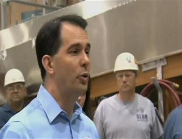 Walker Takes Heat for Budget Tour_3553370080060655806