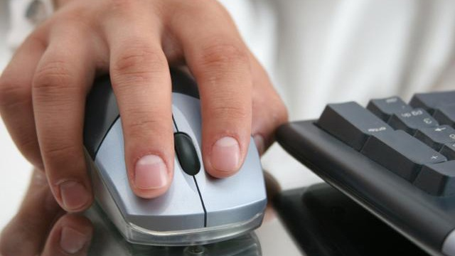 Computer user with mouse and keyboard_9290256264484-159532