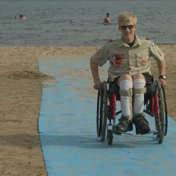 Boy Scout installs beach mat