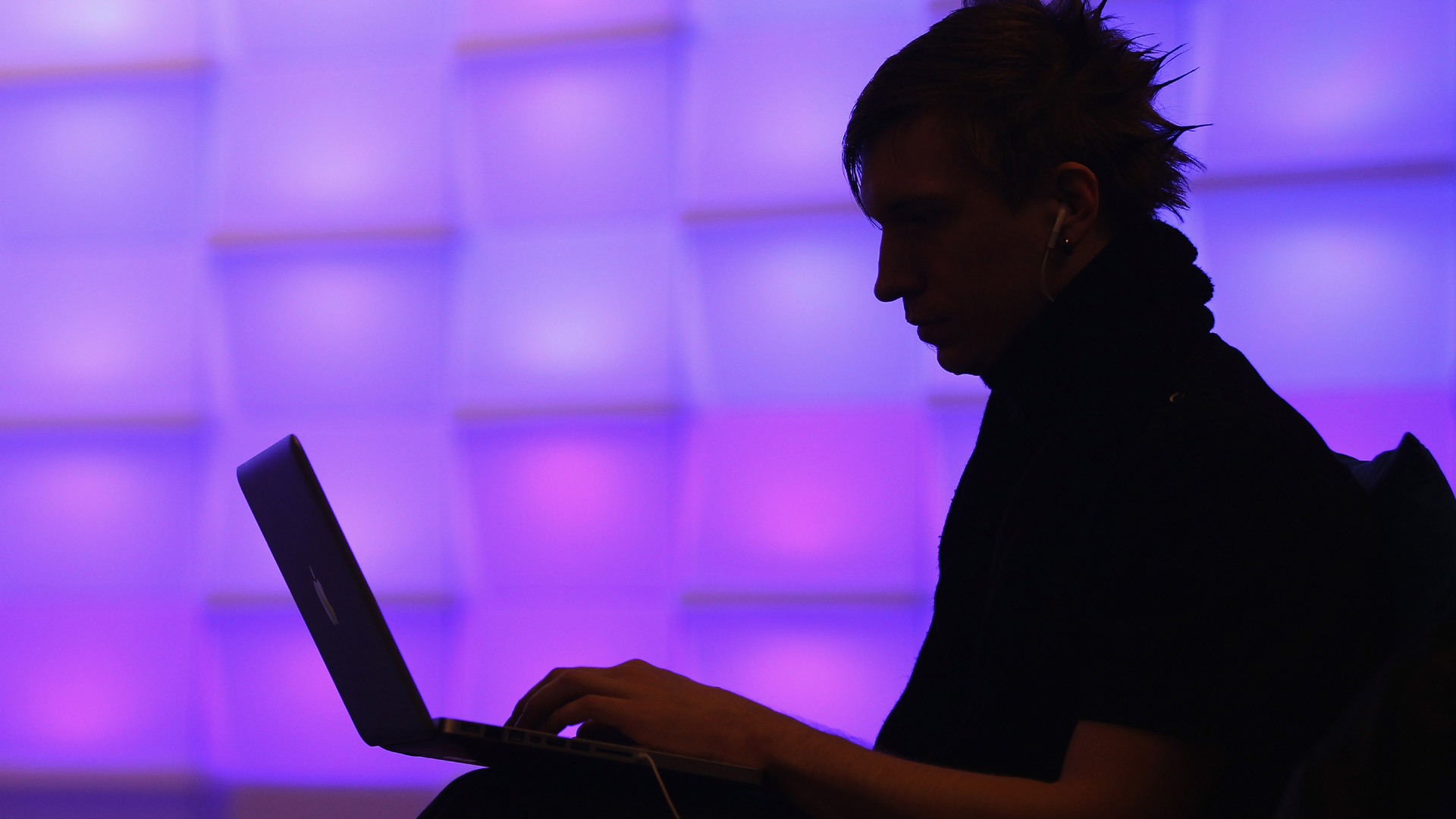 cybersecurity laptop person purple background33897342-159532